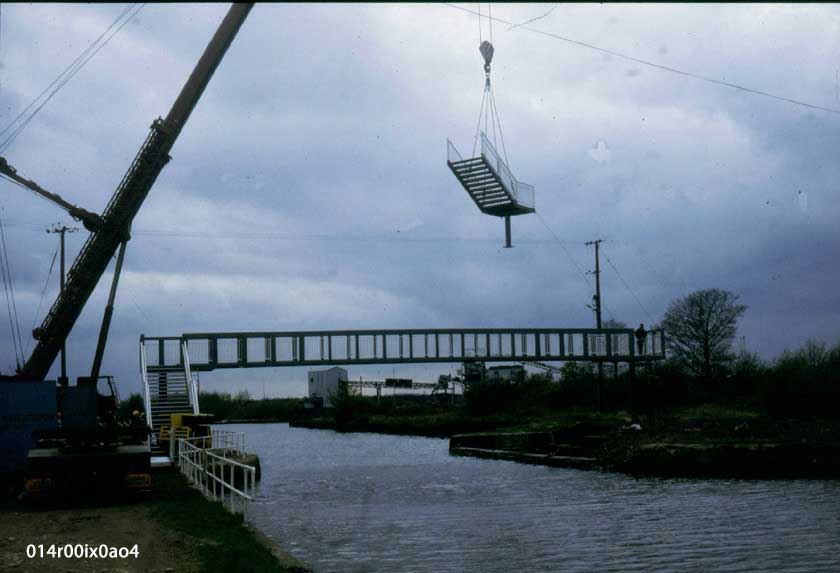 Section of permanent bridge being swung into position